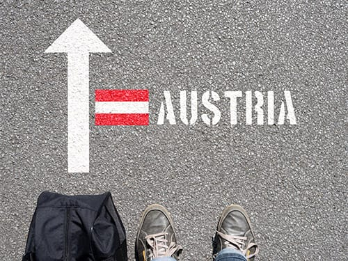 Can I cross the border between Germany and Austria in my hire car?