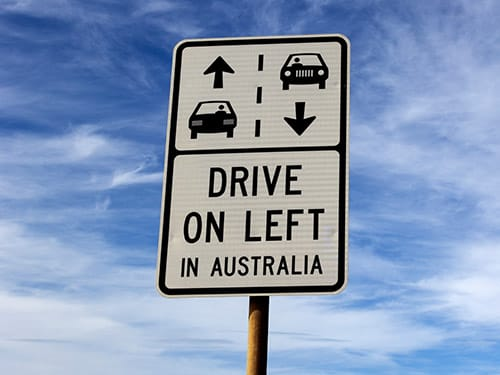 Which side of the road should I drive my hire car on?